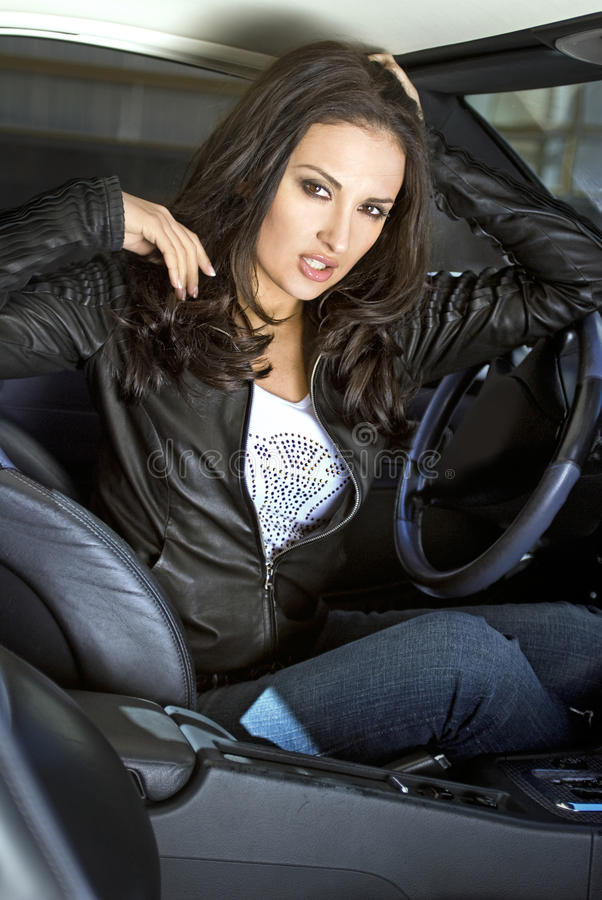 Expressional woman in the sportcar stock photography
