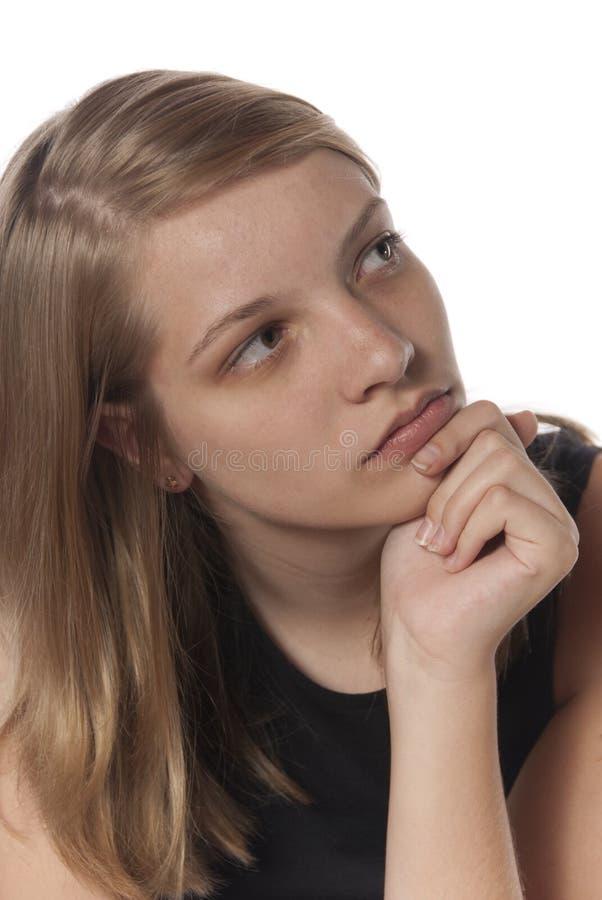 Expressions faciales solennelles de jeune adolescente images libres de droits