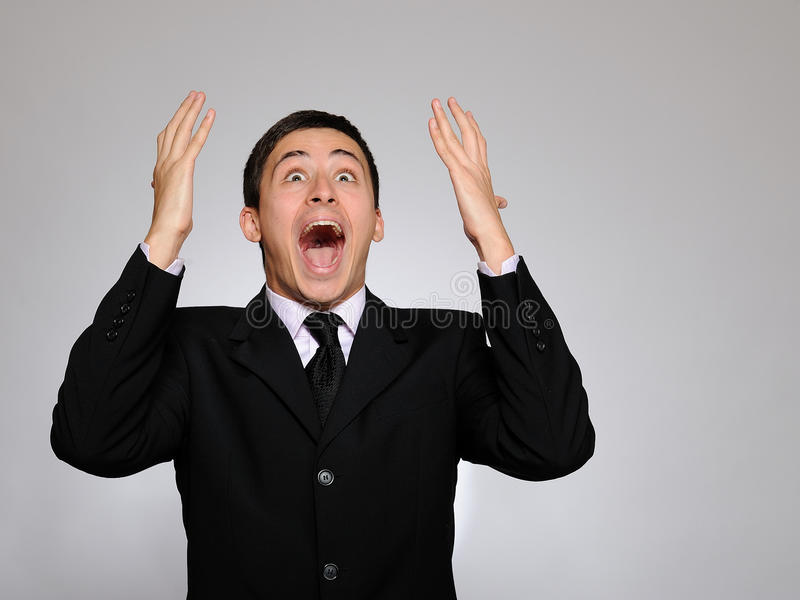Download Expressions. Young Business Man Screaming Stock Photo - Image: 16261880