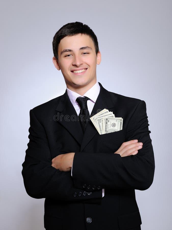 Expressions.Young stattlicher Geschäftsmann mit Geld lizenzfreie stockfotos