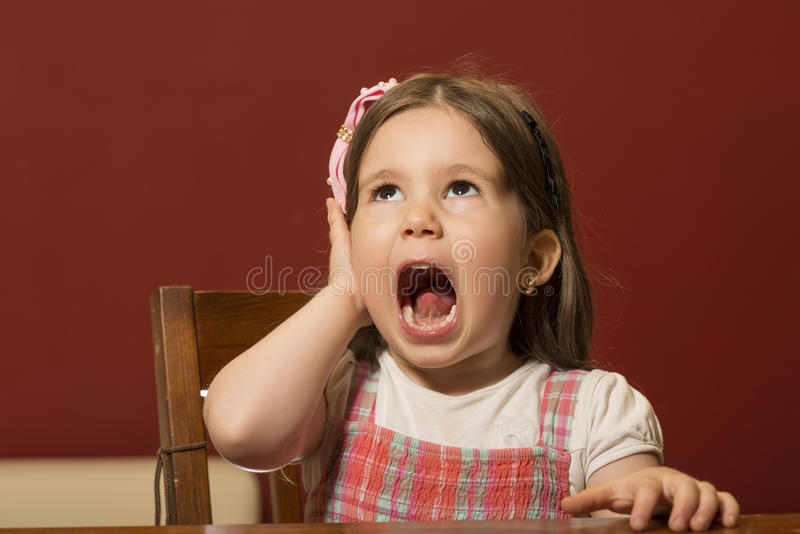 Expressive beautiful little girl playing royalty free stock images