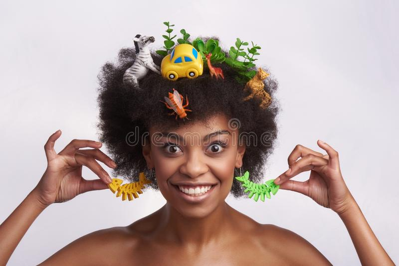 Expressive smiling ethnic female in odd style royalty free stock images