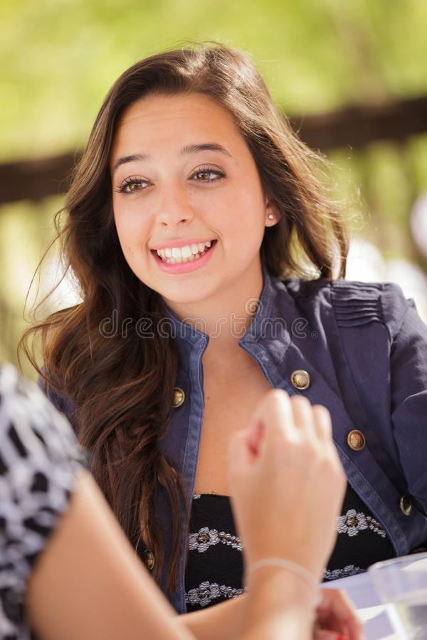 Expressive Young Adult Woman Having Drinks and Talking with Her. Friends Outdoors stock photos