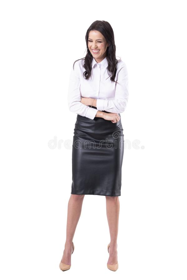 Expressive young business woman laughing loud and hard feeling stomach pain. stock photography