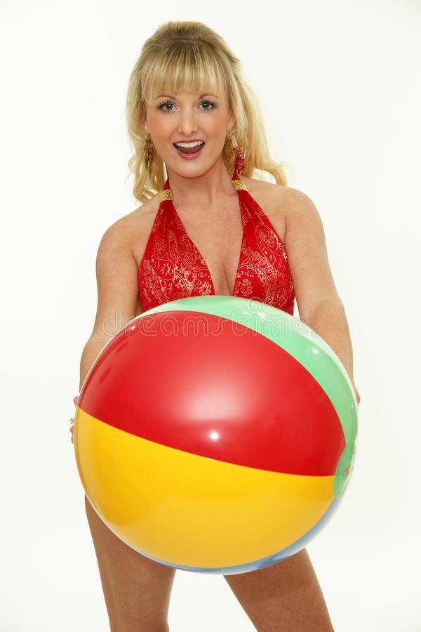 Expressive young woman with beach ball stock photography