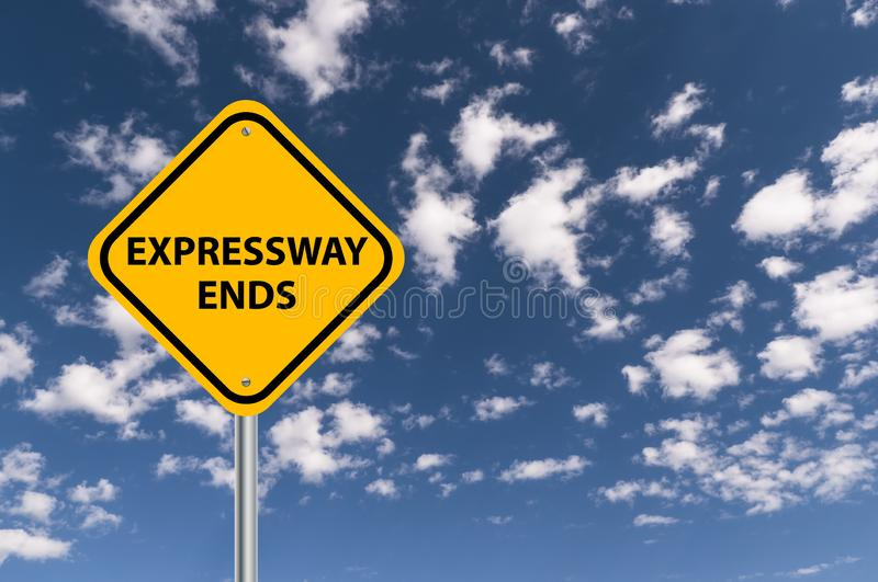 Expressway ends sign. Yellow expressway ends road sign against blue cloudy sky royalty free stock images