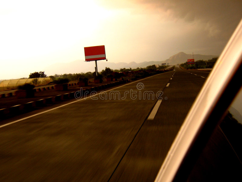Expressway Evening. A colorful evening on an expressway with a beautiful sunset sky stock photography