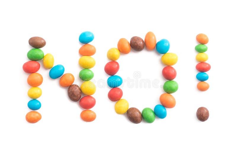 Exprima o nenhum, dos doces coloridos isolados no fundo branco imagens de stock