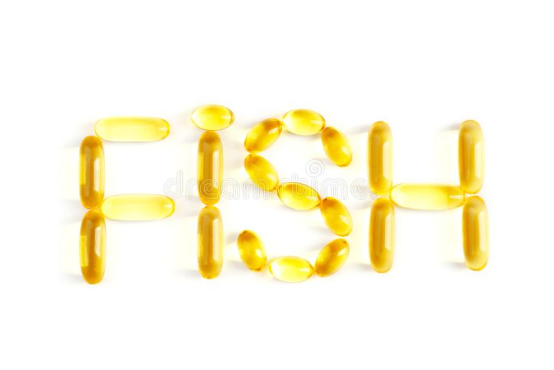 Exprima os PEIXES feitos de cápsulas do óleo de fígado de bacalhau, isolado no branco foto de stock
