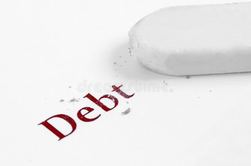 Exprimez la dette inscrite sur la moitié de livre blanc effacée avec la gomme photographie stock