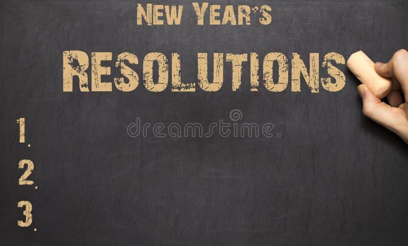 Exprimez la résolution du ` s de nouvelle année écrite sur le tableau noir photos stock