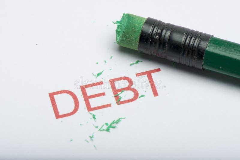 Exprimez le ` de dette de ` sur le papier avec la gomme et les copeaux de crayon usés image stock