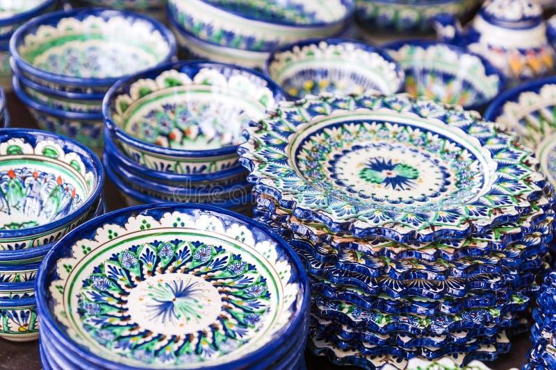 Exquisite colorful Uzbek ceramic dishes stock photos
