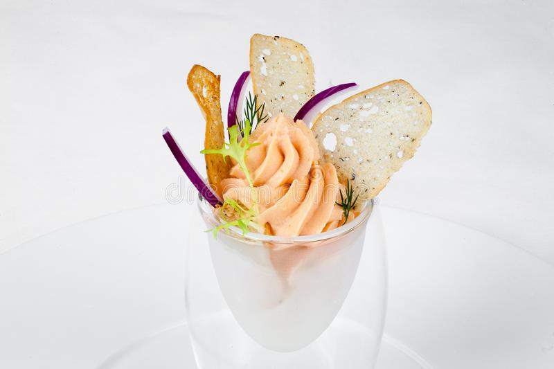 Exquisite fish mousse in a glass goblet. stock photo