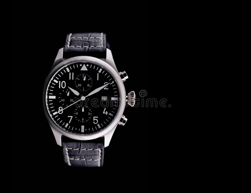 Exquisite Men`s Watch with Leather Belt. Black background and free space royalty free stock photos