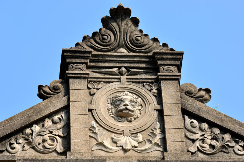 Exquisite sculpture as part of old architecture. Exquisite sculpture detail of architecture in classical style in Xiamen city, South of China, shown as featured stock images