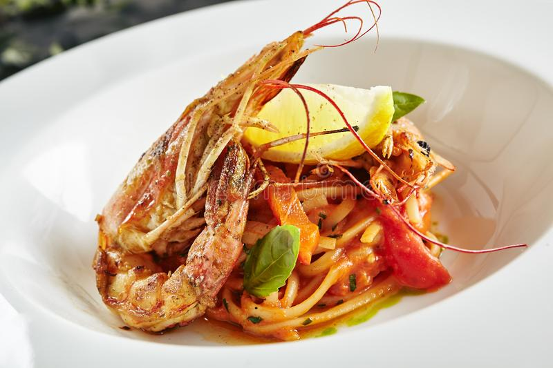 Exquisite Serving Creative Restaurant Food with Grilled Tiger Prawns and Smoked Sweet Pepper Cream Top View stock image