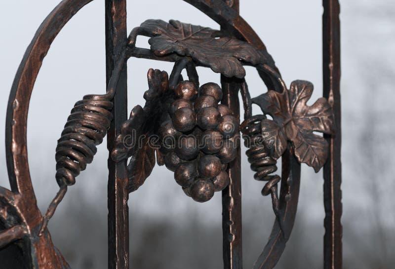 Exquisite wrought iron gates in dark colors stock photos