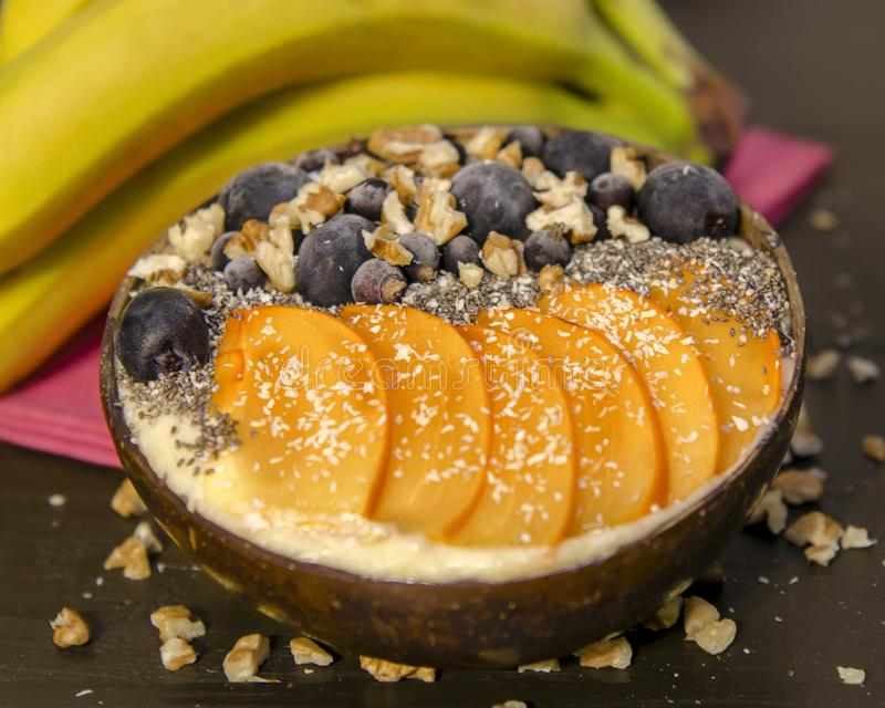 Smoothie bowl with mango and bananas stock photos