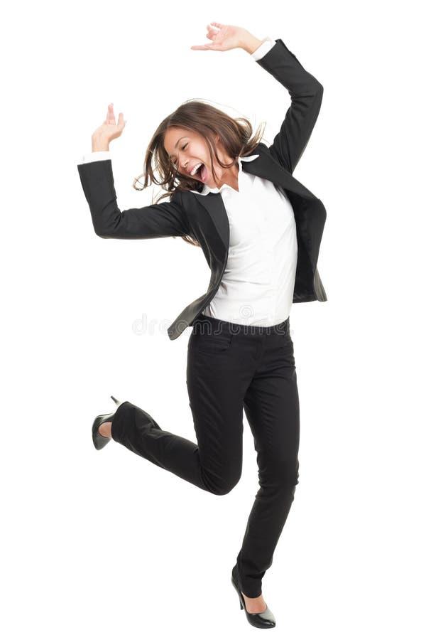 Extatische onderneemster in kostuum het dansen stock fotografie