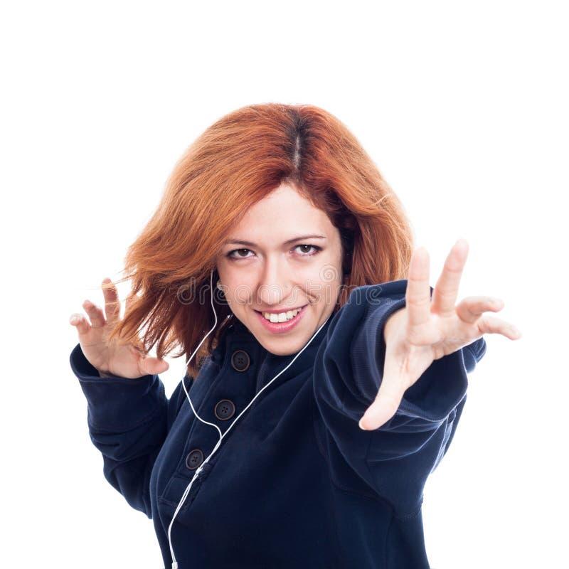 Extatische vrouw met oortelefoons royalty-vrije stock foto's