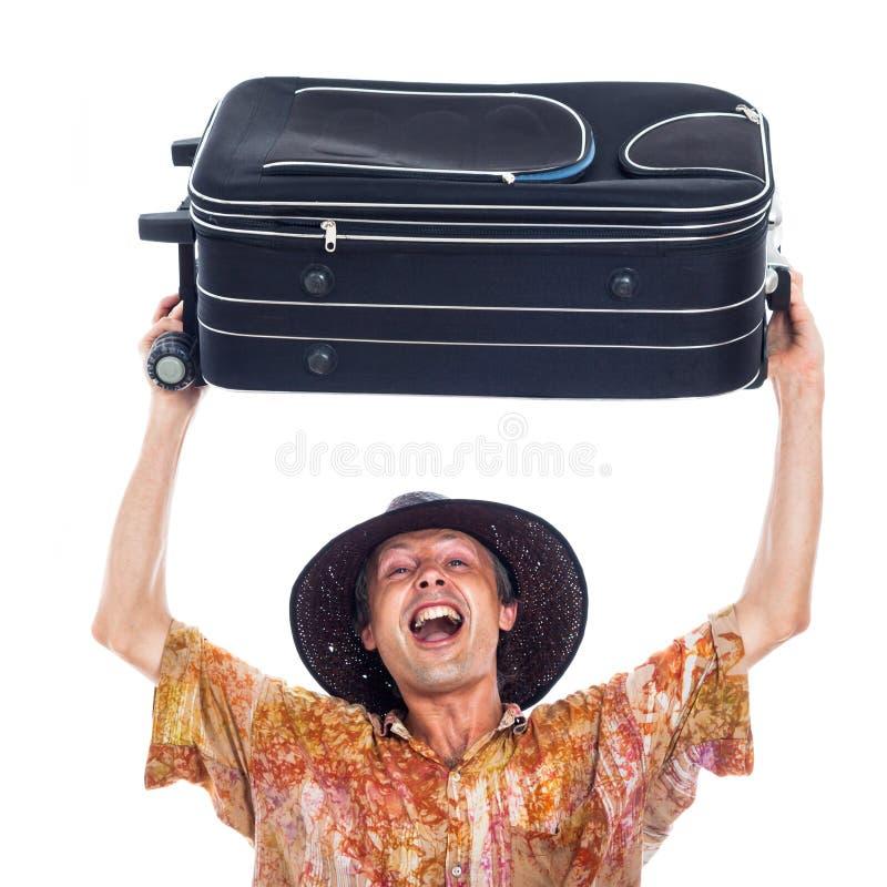 Extatisk lycklig handelsresande med bagage fotografering för bildbyråer
