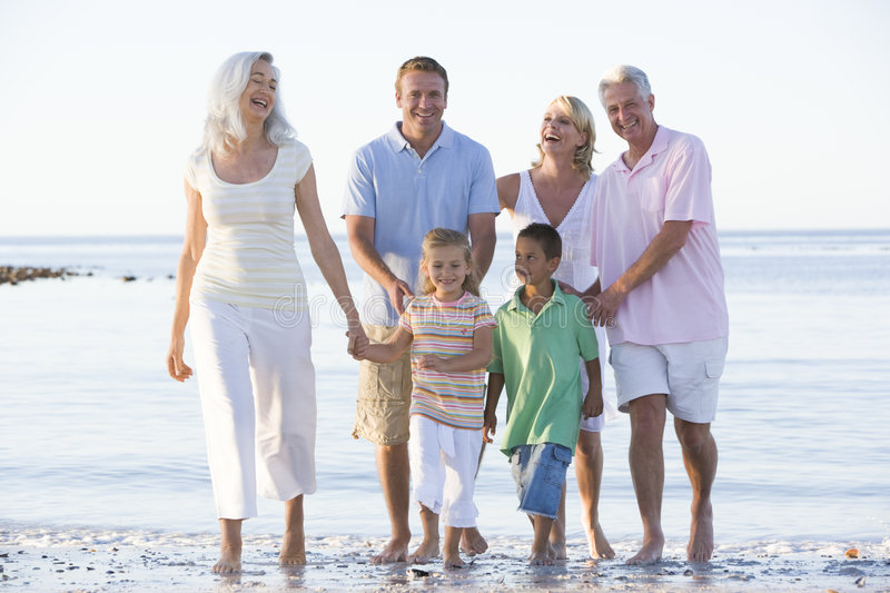 Extended family at the beach smiling stock photo