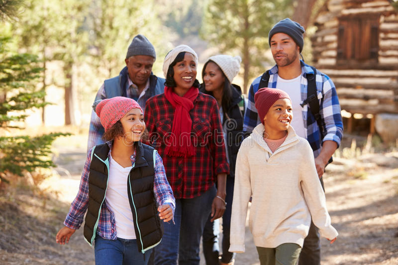 Extended Family Group On Walk Through Woods In Fall stock photos