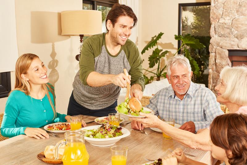 Extended family having lunch at home stock image