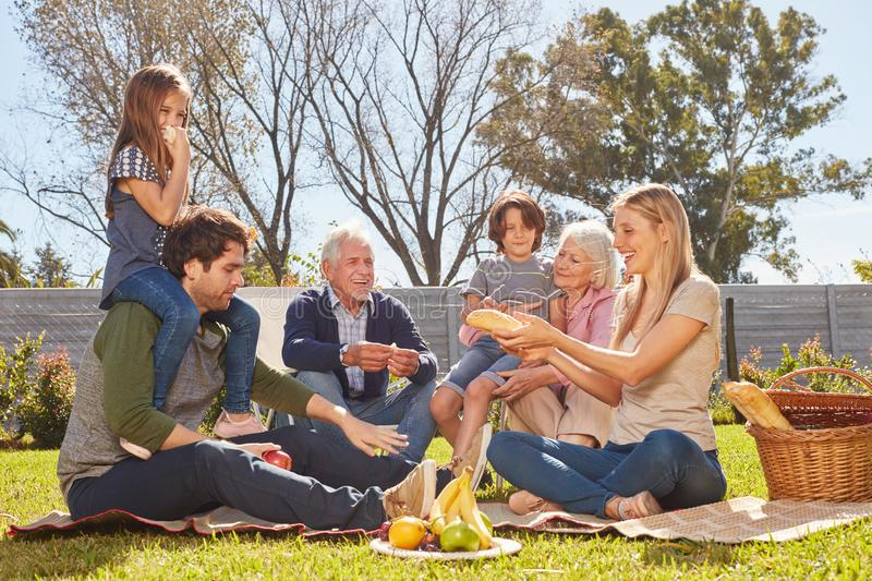 Extended family having a picnic in the garden royalty free stock photo