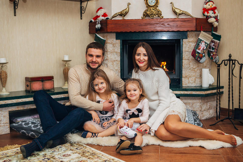 Extended Family Relaxing Together at the fireplace royalty free stock photo