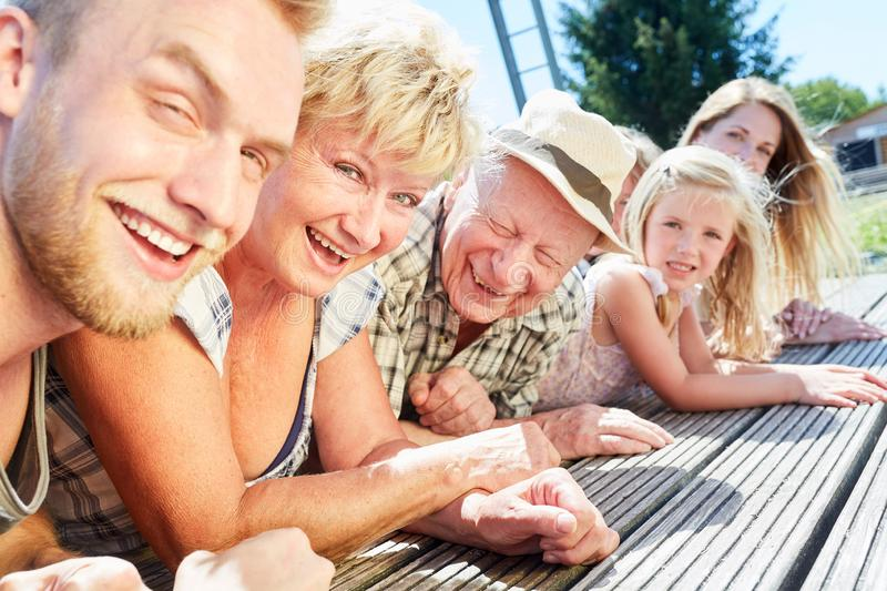 Extended family in the summer vacation at the lake royalty free stock image