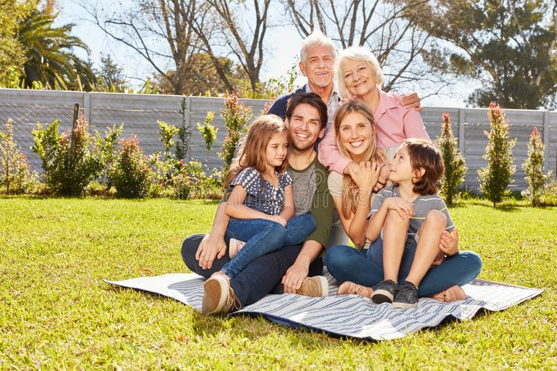 Extended family with three generations in the garden stock images