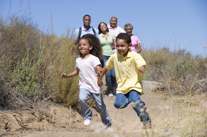 Extended Family walking in countryside royalty free stock photography