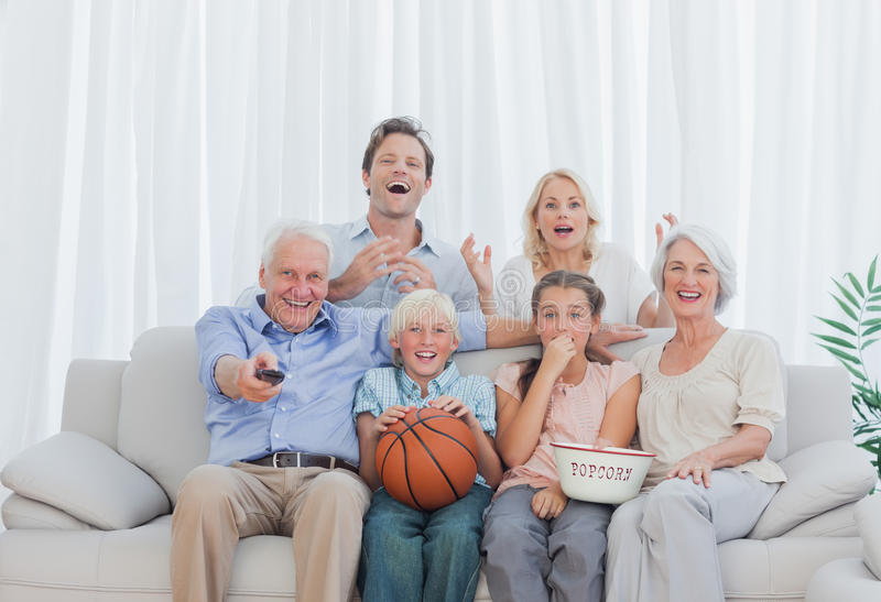 Extended family watching the television stock images
