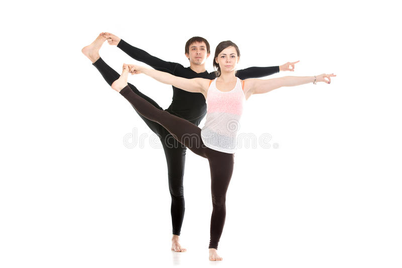 Extended Hand-To-Big-Toe yoga pose with partner stock photography