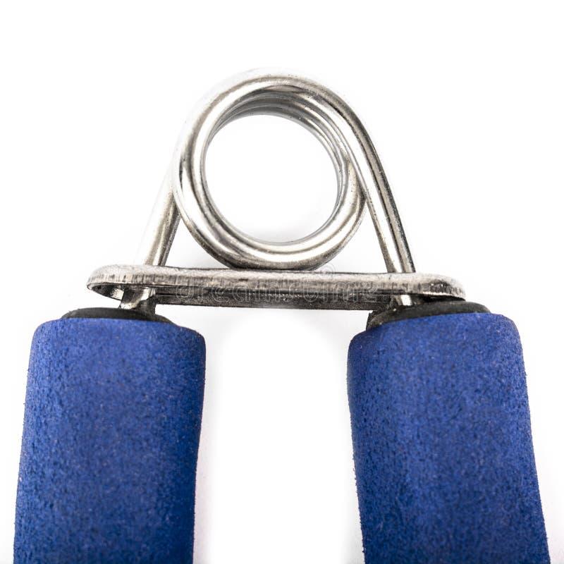 Extenseur avec des poignées de bleu d'isolement sur le fond blanc photographie stock libre de droits
