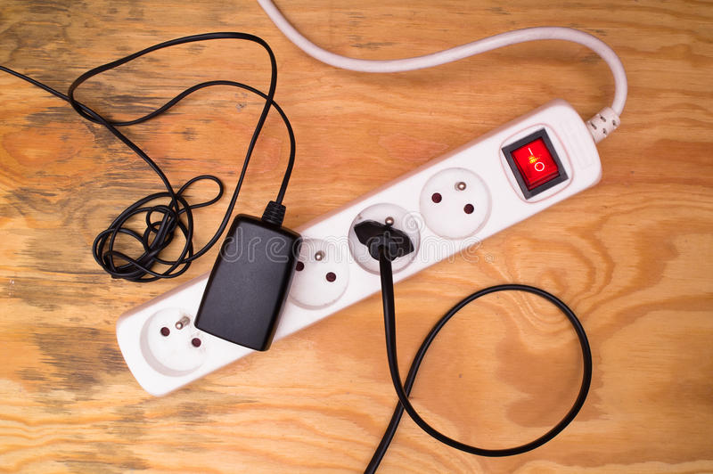 Extension cord and plugged cables royalty free stock image