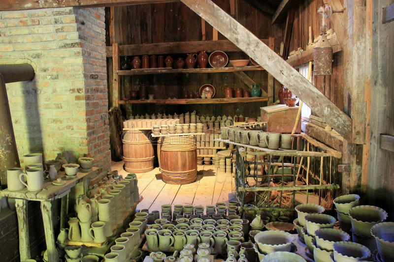 Extensive display of pottery in potter's room,Old Sturbridge Village,September,2014 royalty free stock photography