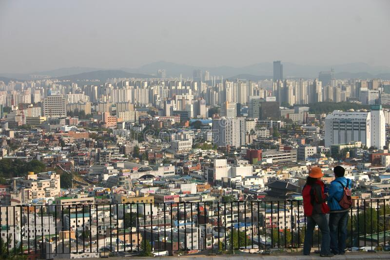 Suwon City, South Korea. An extensive view over Suwon City, in the greater Seoul region, South Korea, from the ancient fortress and city walls which overlook the stock photos