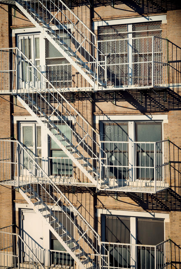 Exterior of a building with old fire escape in New York City royalty free stock photos