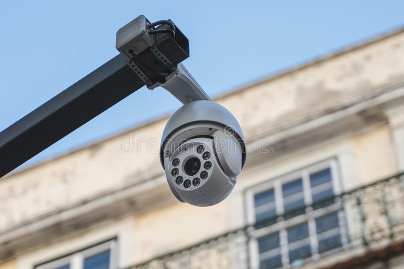 Exterior CCTV camera mounted on a steel pole, Lisbon, Portugal. Led lighting on demand for night vision stock photography