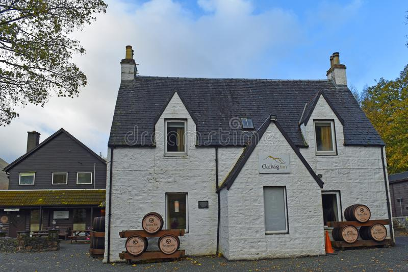 Exterior of Clachaig Inn in Glencoe, Scottish Highlands. Exterior of Clachaig Inn showing whitewashed walls, windows and advertising beer barrels. The Clachaig stock image