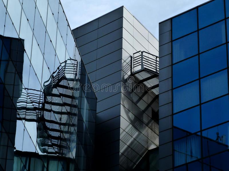 Exterior detail of blue glass & aluminum curtain walled office building royalty free stock photo