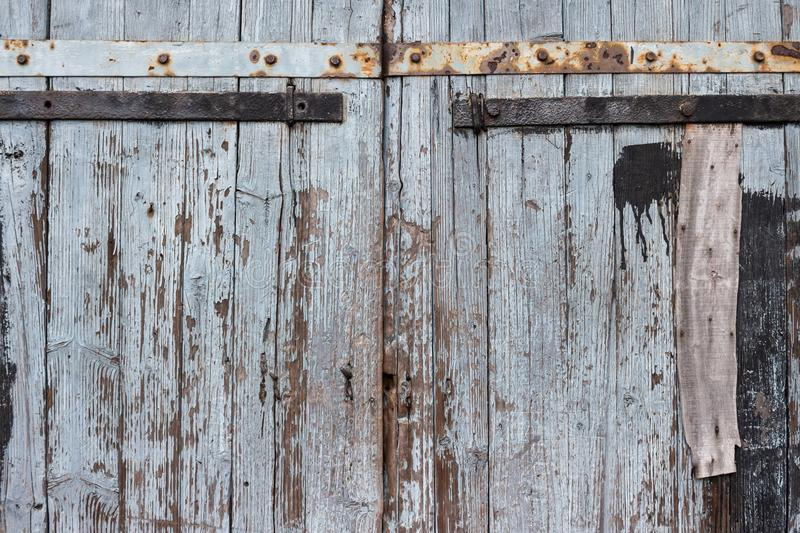 Doors of an old wooden barn. Exterior doors of an old wooden barn in village royalty free stock photography