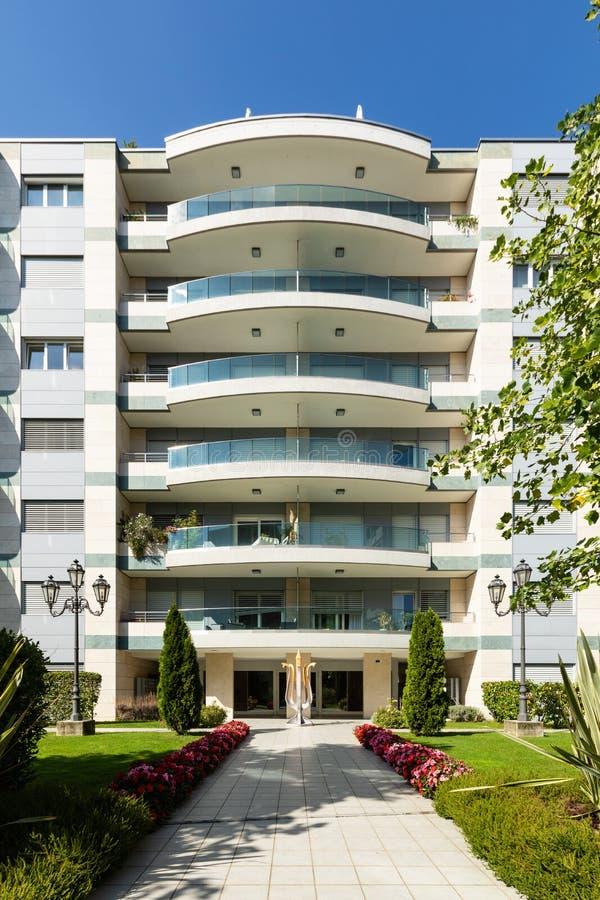 Exterior elegant modern condominium with garden stock images