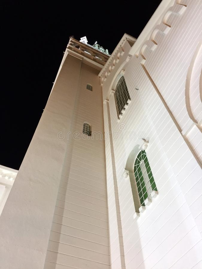 Exterior Facade of Catholic Church in Montecrisiti, Ecuador. Exterior facade of the Catholic church at night time with lights accenting the building details royalty free stock photos