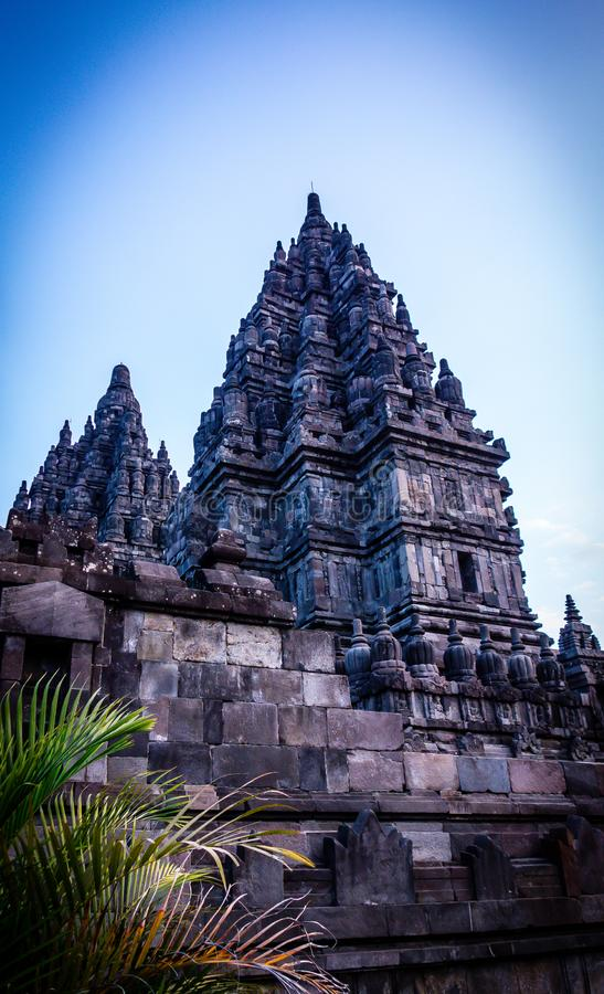 Facade of Prambanan Temple, Yogyakarta, Indonesia. Exterior facade of stone Prambanan Temple in Yogyakarta, Indonesia against blue skies with copy space stock image
