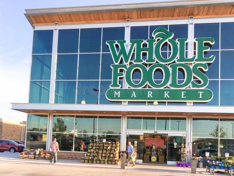 Exterior facade of Whole Foods Market store in Irving, Texas, US. IRVING, TX, US-APR 3, 2018:Exterior facade of Whole Foods Market store customer walk out, exit stock images