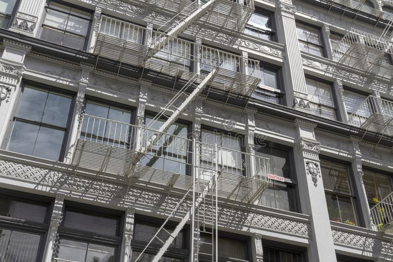 Exterior fire escape stairs on the outside of an old brick building. New York royalty free stock photography
